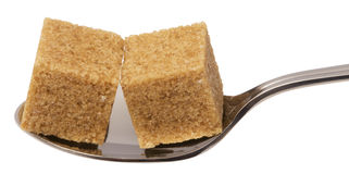 Cube of brown sugar on spoon Stock Photo