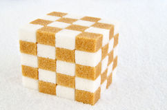 Cube of brown and white sugar cubes Royalty Free Stock Image