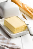 Cube of butter with bread Royalty Free Stock Image