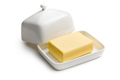 Cube of butter. In ceramic jar stock photos