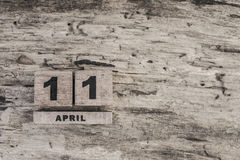 Cube calendar for april on wooden background. With copy space Stock Photography