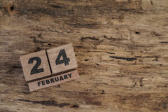 Cube calendar for february on wooden background. With copy space Royalty Free Stock Photos
