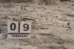 Cube calendar for february on wooden background. With copy space Stock Image