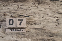 Cube calendar for february on wooden background. With copy space Royalty Free Stock Photography