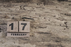 Cube calendar for february on wooden background. With copy space Royalty Free Stock Images