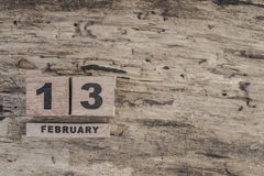 Cube calendar for february on wooden background. With copy space stock photos