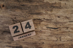 Cube calendar for january on wooden background. With copy space Stock Image