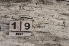 Cube calendar for june on wooden background Stock Photos