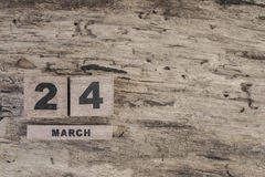 Cube calendar for march on wooden background. With copy space Royalty Free Stock Photos