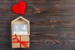 Cube calendar with red heart and gift box on wooden table with copy space. 14 February concept stock photos