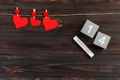 Cube calendar with red hearts on wooden table with copy space. 14 February concept stock photo