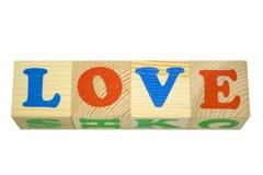 Cube en bois avec AMOUR d'inscription Photographie stock
