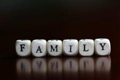 Cube en lettre de famille des textes Images stock