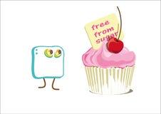 Cube en sucre devant le petit gâteau Image stock