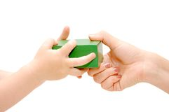 Cube in female and children's hands Royalty Free Stock Image
