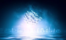 Innovative technologies and environment. Cube figure reflecting in sea waves. 3d rendering Royalty Free Stock Photos