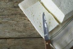 Cube of fresh feta cheese Stock Photography