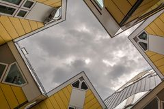 Cube Houses in Rotterdam, Netherlands viewed from beneath in dull cloudy day stock photo