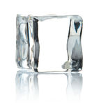 Cube of ice. On white background stock photos