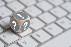 Cube on a keyboard with an exclamation mark on top Royalty Free Stock Photo