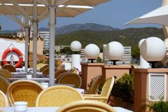 Cube lamps over beach in Paguera. Cozy reastaurant immediately at Mediterranean Sea, Mallorca, Espana, waiting for guests Royalty Free Stock Photography