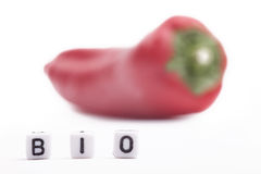 Cube Letters Bio in Front of a unsharp red pepper Stock Image