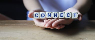 Connect. Cube letters about connecting relationships, having the ability and skills to connect with people on palms of hand stock images