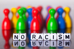 Cube Letters show the words  no racism Royalty Free Stock Photo