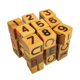 Cube made of wooden blocks with numbers and letters. Isolated over white stock photos