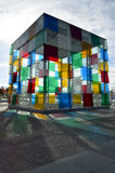 The Cube of Malaga with colorful reflections (vertical orientation). Malaga, Spain - January 3, 2016: The colourful Cube of Malaga, in the Centre Pompidou of stock images