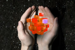 Cube in male hand . Mixed media. Conceptual image with 3D rendering cube figure in male palms Stock Photography
