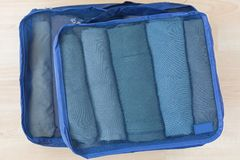 Free Cube Meshed Bags With Rolled Clothes. Set Of Travel Organizer To Help Packing Well Organized Stock Photography - 134644662