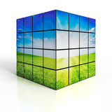 Cube with nature landscape on white background Royalty Free Stock Photography