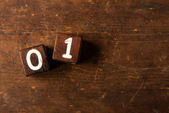Cube numbers on old wooden table with copy space, 01 Royalty Free Stock Photography