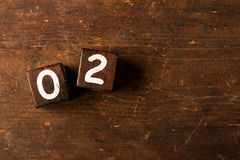 Cube numbers on old wooden table with copy space, 02 Stock Image