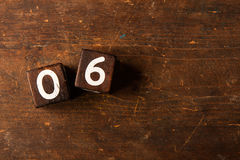 Cube numbers on old wooden table with copy space, 06 Stock Photo