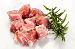Cube pork neck with rosemary on white Royalty Free Stock Photo