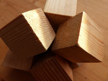 Cube on the rib. Construction from wooden cubes. Abstraction. Closeup. Royalty Free Stock Photography