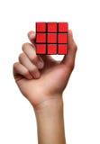 Cube rouge en puzzle de résolution des problèmes Image stock