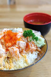 Cube salmon spicy salad on rice with crunchy on top. Background stock photo