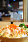 Cube salmon spicy salad on rice with crunchy on top. Background royalty free stock images