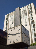 Cube Saped Clock and Modern Apartment Building Royalty Free Stock Photo
