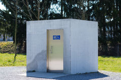 Cube shaped Toilet building stock image
