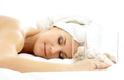 Cube of shells. Beautiful lady in spa salon with sea shells in glass cube Stock Image