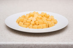 Cube sliced cheese Stock Photography