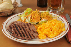 Cube steak dinner. A cube steak dinner with macaroni and cheese and a salad stock photo