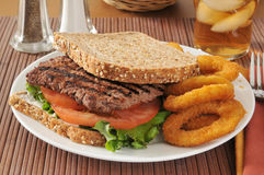 Cube steak sandwich. A cube steak sandwich on sprouted whole grain, nut and seed bread royalty free stock photo