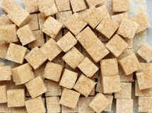 Cube sugar. Brown cube sugar is used as background Stock Photo