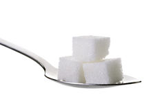 Cube sugars in teaspoon  on white background. Cube sugars in teaspoon isolated on white background Stock Photos