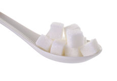 Cube sugars in teaspoon  on white background Stock Images